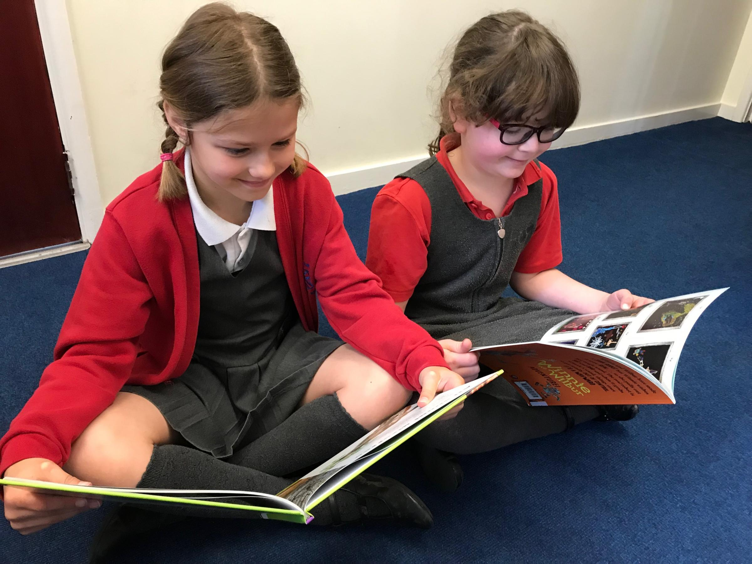 Grove Primary School gets Persimmon donation for library books