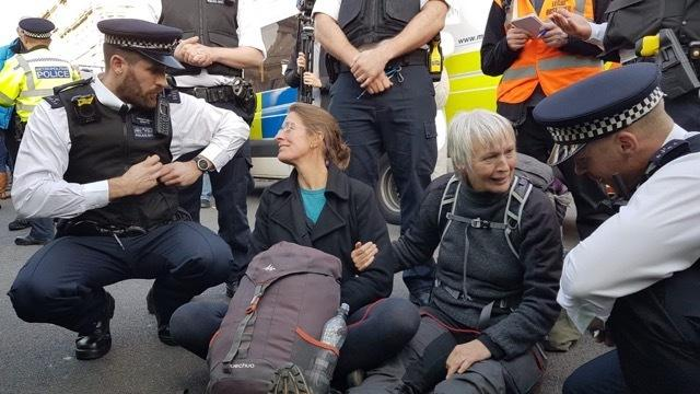 Activist Rowan Tilly (right). Picture: Zoe Broughton