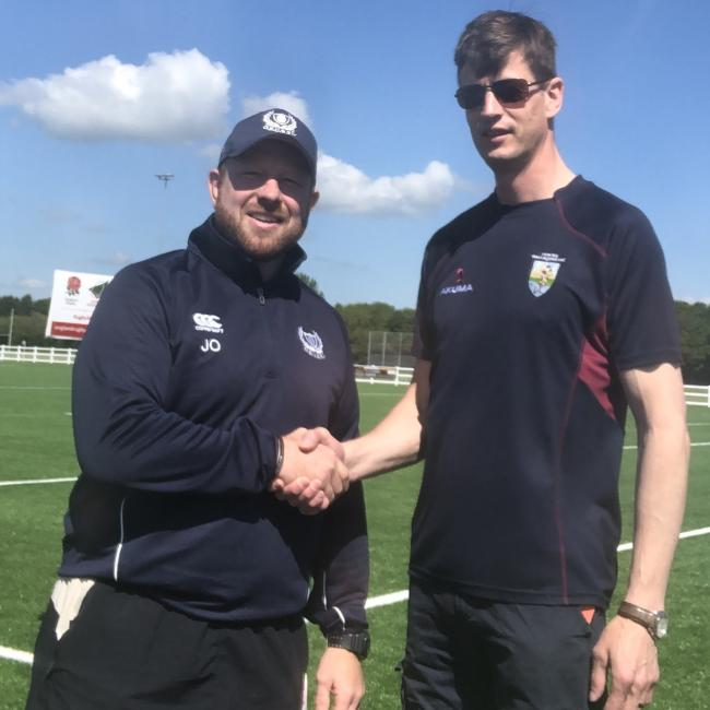 Oxford Brookes director of rugby Joe Winpenny (left) shakes hands with Oxford Harlequins facilities manager James Knox