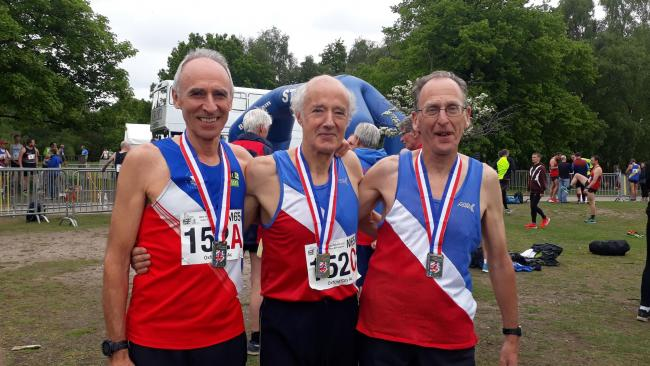 Oxford City's (from left) Stewart Thorp, John Exley and Roy Treadwell with their gold medals at the BMAF Road Relay Championships