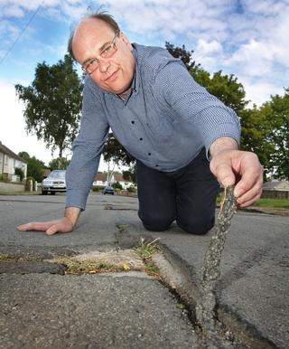 Anthony Baker is fed up with the crumbling state of roads around his home in Marston