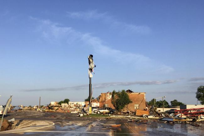 Debris lies on the ground at a hotel after a deadly storm moved though a town in Oklahoma