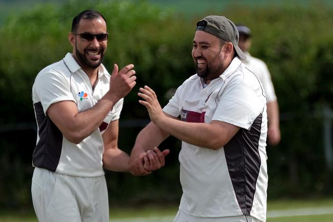 A delighted Majid Khan celebrates one of his four wickets as Garsington & Cowley beat Marsh Gibbon Picture: Ric Mellis