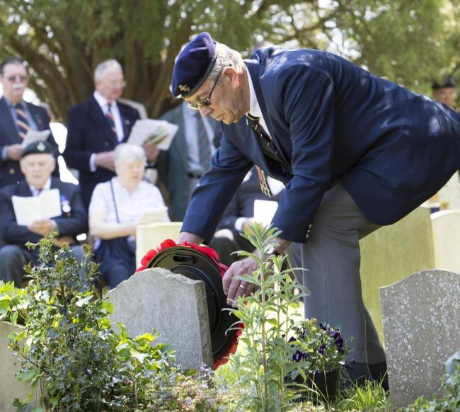 Major John Howard's cousin Derek Chivers lays a wreath at his grave in Clifton Hampden in 2017 Picture Damian Hailliwell