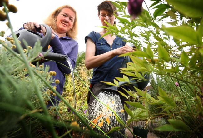 Helen Osborn and gardener Ruth Calder at a garden open day at the Barracks Lane Community Garden last year. Picture by Richard Cave