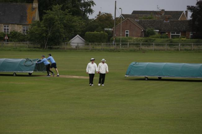Rain forces an early lunch during Thame Town's Division 2 match with Oxford Picture: Ed Nix